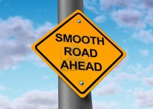 11410888-smooth-road-ahead-good-times-recovery-yellow-street-sign
